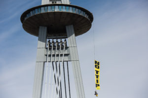 "Ten climbers from Austria, Slovakia and Croatia scale Bratislava's UFO tower over the Danube to display a banner reading ""NO TTIP"", as ministers meet in the city below to decide the fate of EU trade deals with the US and Canada."